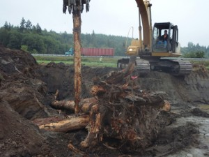 Pounding in pilings during log jam installation