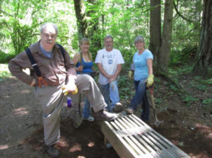 Our intrepid volunteers rebuilt and relocated the benches to their original homes.